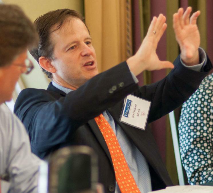 Jim Faulkner-Regional Managing Director of Kroll-leading the discussion.